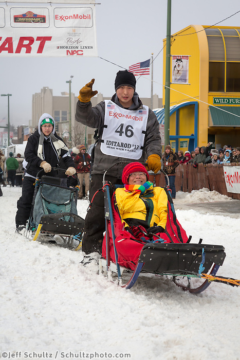 Michael Williams  Jr. and team leave the ceremonial start line at 4th Avenue and D street in downtown Anchorage during the 2013 Iditarod race. Photo by Jim R. Kohl/IditarodPhotos.com