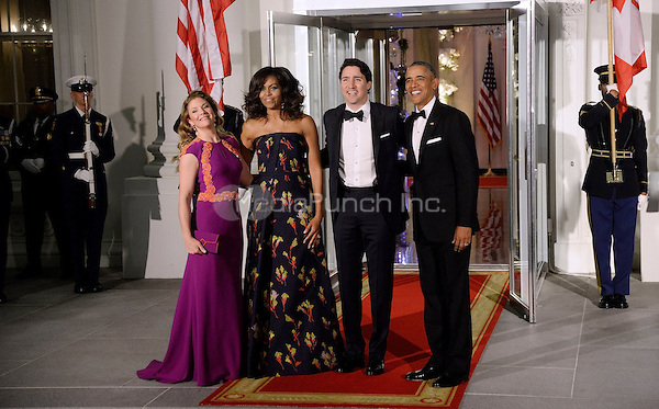 United States President Barack Obama, right, and First Lady Michelle Obama, center left, greet Prime Minister Justin Trudeau, center right, and Mrs. Sophie Gr&Egrave;goire Trudeau, left, of Canada on the North Portico of the White House March 10, 2016 in Washington,D.C. <br /> Credit: Olivier Douliery / Pool via CNP/MediaPunch