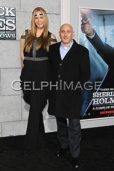 "NICOLE ROBINOV, JEFF ROBINOV. Los Angeles Premiere of Warner Brothers Pictures' ""Sherlock Holmes: A Game of Shadows,"" at the Regency Village Theatre in Westwood. Los Angeles, CA USA. December 6, 2011.©CelphImage"