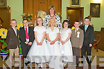 COMMUNION: Making their First Holy Communion on Saturday in Ballyhahill were l-r: Jack O'Shaughnessy, Dylan Scanlon, A?ine Leahy, Hayley Betts, Megan Moloney Farrell, Darren McElligott and Stephen Martin. Standing at back is teacher Fiona Hartnett.   Copyright Kerry's Eye 2008