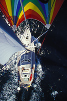 Sailing yacht 'Heron', a Halberg-Rassy 46 under spinnaker, seen from mast top in tradewinds in tropical waters
