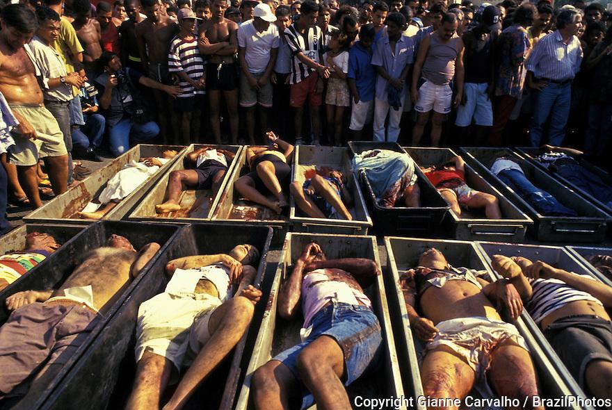 "Police violence.  Slaughtering of slum dwellers in Rio de Janeiro, Brazil in 1993 known as ""Massacre de Vigario Geral""."