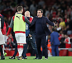 Arsenal's Shkodran Mustafi celebrates with Gary Neville during the premier league match at the Emirates Stadium, London. Picture date 11th August 2017. Picture credit should read: David Klein/Sportimage