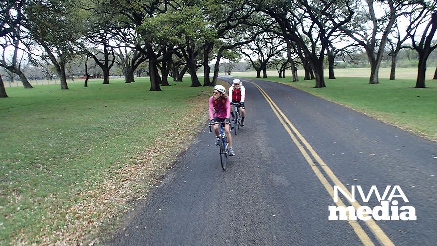 NWA Democrat-Gazette/FLIP PUTTHOFF <br /> Karen and Tom Mowry of Nob Hill bike through the LBJ ranch, now a national park in central Texas.