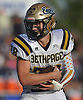 T.J. Hart #28 of Bethpage picks up yards during a Nassau County Conference III varsity football game against host Lawrence High School on Saturday, Oct. 7, 2017.