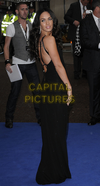 MEGAN FOX.'Transformers: Revenge of the Fallen' .UK film premiere at Odeon cinema, Leicester Square, London, England..15th June 2009.2 two full length black dress looking over shoulder backless straps long maxi tattoo .CAP/CAN.©Can Nguyen/Capital Pictures.
