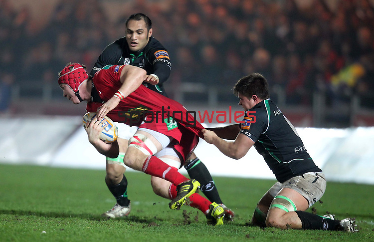 Dave Heffernan and George Naoupu tackle Kieran Murphy..RaboDirect Pro12.Scarlets v Connacht.02.03.12.©STEVE POPE