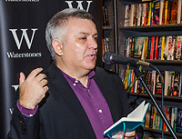Henry McDonald, journalist, author, Belfast, N Ireland, UK, speaking at launch of Crossing the Line by Martin Dillon. McDonald writes for The Guardian &amp; The Observer,The event took place in Waterstones, Fountain Street, Belfast, 21st September 2017. 201709214592<br /><br />Copyright Image from Victor Patterson, 54 Dorchester Park, <br />Belfast, UK, BT9 6RJ<br /><br />t1: +44 28 9066 1296 (from Rep of Ireland 048 9066 1296)<br />t2: +44 28 9002 2446 (from Rep of Ireland 048 9002 2446)<br />m: +44 7802 353836<br /><br />victorpatterson@me.com<br />www.victorpatterson.com<br /><br />Please see my Terms and Conditions of Use at VICTORPATTERSON.COM. It is IMPORTANT that you familiarise yourself with them.<br /><br />Images used on the Internet must be visibly watermarked i.e. &copy;VICTORPATTERSON.COM within the body of the image and copyright metadata must not be deleted. Images used on the Internet have a size restriction of 4kbs and are chargeable at the then current NUJ rates.<br /><br />This image is only available for the use of the download recipient i.e. television station, newspaper, magazine, book publisher, etc, and must not be passed on to any third party. It is also downloaded on condition that each and every usage is notified within 7 days to victorpatterson@me.com<br /><br />The right of Victor Patterson to be identified as the author is asserted in accordance with The Copyright Designs And Patents Act (1988).