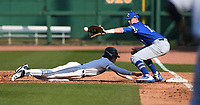 NWA Democrat-Gazette/J.T. WAMPLER  Springdale Har-Ber's Hunter Wood jumps back to first base to avoid the pick-off throw to Rogers' Matthew Watson Monday March 12, 2018 at Arvest Ballpark in Springdale. Rogers beat the Wildcats 1-0.