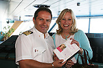 Capt. Orazio D'Aita - Master Italy (Captain of Carnival's Glory) & Tina Sloan & Changing Shoes Book - Day 5 Wednesday - August 4, 2010 - So Long Springfield at Sea - A Final Farewell To Guiding Light sets sail from NYC to St. John, New Brunwsick and Halifax, Nova Scotia from July 31 to August 5, 2010  aboard Carnival's Glory (Photos by Sue Coflin/Max Photos)