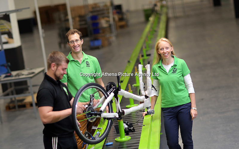 Pictured: Owners Shelley (R) and Jerry Lawson (C) with Jack Appleby (L) on the assembly line Monday 15 August 2016<br />