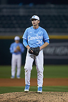 North Carolina Tar Heels relief pitcher Caden O'Brien (34) looks to his catcher for the sign against the Charlotte 49ers at BB&T BallPark on March 27, 2018 in Charlotte, North Carolina. The Tar Heels defeated the 49ers 14-2. (Brian Westerholt/Four Seam Images)