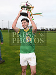 Curraha captain Danny Battersby lifts the under 21 Football Championship trophy after beating Wolfe Tones in the final. Photo: Colin Bell/pressphotos.ie