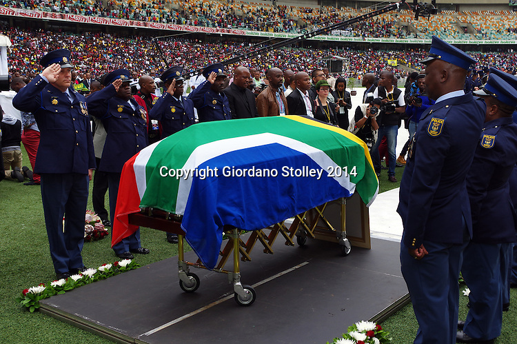 DURBAN - 1 November 2014 - An honour guard of the South African Police Services salute as the national anthem is played at the funeral of slain South African soccer captain Senzo Meyiwa in Durban's Moses Mabhida Stadium. Meyiwa, who was also the goal keeper for Orlando Pirates, was gunned down in Vosloorus a week earlier. Picture: Allied Picture Press/APP