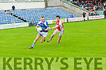 John Barry Keane (KOR) in action with ) Paul Murphy (Rathmore) in the Garvey's SuperValu Senior County Football Championship 2015 at Austin Stack Park,Tralee on Saturday evening