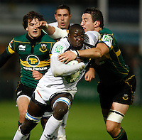 Photo: Richard Lane/Richard Lane Photography. Northampton Saints v Castres Olympique. Heineken Cup. 08/10/2010. Castre's Ibrahim Diarra is tackled by Saints' Phil Dowson.