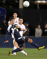 Michael Nanchoff #9 of the University of Akron sends the ball past Soony Saad #8 of the University of Michigan during the 2010 College Cup semi-final at Harder Stadium, on December 10 2010, in Santa Barbara, California.Akron won 2-1.