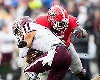 ATHENS, GA - NOVEMBER 23: Devonte Wyatt #95 of the Georgia Bulldogs tackles Kellen Mond #11 of the Texas A