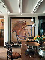 This contemporary artwork is a strong feature of the open plan living/dining area