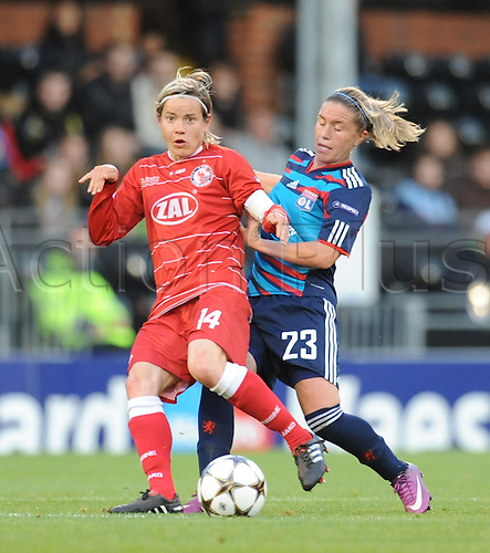 26.05.2011. London England.  Womens Champions League Final from Craven Cottage in London. FFC Turbine Potsdam v Olympique Lyonnais. Lyonnaise won 2-0. Camille Abily of Lyonnaise and Jennifer Zietz of Potsdam battle for the ball