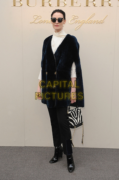 LONDON, ENGLAND - FEBRUARY 22: Erin O'Connor attends the Burberry Prorsum Womenswear A/W 2016 fashion show on West Albert Lawns in Kensington Gardens on February 22, 2016 in London, England.<br /> CAP/BEL<br /> &copy;Tom Belcher/Capital Pictures