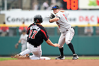 Indianapolis Indians second baseman Blake Davis (10) turns a double play as Doug Bernier (17) slides in during a game against the Rochester Red Wings on July 26, 2014 at Frontier Field in Rochester, New  York.  Rochester defeated Indianapolis 1-0.  (Mike Janes/Four Seam Images)