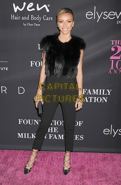 SANTA MONICA, CA- OCTOBER 18:  TV personality Giuliana Rancic attends Elyse Walker presents the 10th anniversary Pink Party hosted by Jennifer Garner and Rachel Zoe at HANGAR 8 on October 18, 2014 in Santa Monica, California.<br /> CAP/ROT/TM<br /> &copy;Tony Michaels/Roth Stock/Capital Pictures