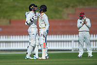Wellington's Devon Conway celebrates his double century with Wellington's Peter Younghusband during day one of the Plunket Shield cricket match between the Wellington Firebirds and Canterbury at Basin Reserve in Wellington, New Zealand on Tuesday, 29 October 2019. Photo: Dave Lintott / lintottphoto.co.nz
