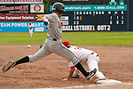 Tuesday, July 14, 2009.  Boise Hawks 2nd baseman Logan Watkins (left), out at first after a hitting a ground ball to Vancouver shortstop Michael Gilmartin, who threw to 1st baseman Anthony Aliotti. The Vancouver Canadians went on to win the game against The Boise Hawks 3-2 at Nat Bailey Stadium in Vancouver.   Photo by Gus Curtis.