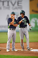 Vermont Lake Monsters manager Aaron Nieckula (26) talks with Luke Persico (32) during a game against the Auburn Doubledays on July 12, 2016 at Falcon Park in Auburn, New York.  Auburn defeated Vermont 3-1.  (Mike Janes/Four Seam Images)