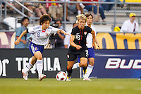 14 MAY 2011:Japan National team Aya Miyama and USA Women's National Team midfielder Lori Lindsey (16) go after the ball  during the International Friendly soccer match between Japan WNT vs USA WNT at Crew Stadium in Columbus, Ohio.
