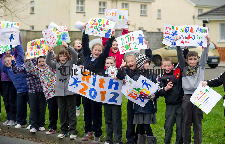Pupils from St Aidan's National School waiting for the Rith 2012 Irish Language Relay Race to pass through Shannon. Photograph bY Declan Monaghan