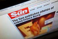 The website of Rupert Murdoch's The Sun newspaper showing naked photos of the royal family's Prince Harry naked with a woman in Las Vegas is seen on Friday, August 24, 2012. UK newspapers have been reluctant to print the bawdy photos because of fear of the Press Complaints Commission and the possible invasion of privacy issues.  The Sun decided to publish the photos because ?This is about our readers getting involved in the discussion with the man who is third in line to the throne. It's as simple as that?, not to mention that the photos have been readily available on the internet for anyone to see. (© Richard B. Levine)