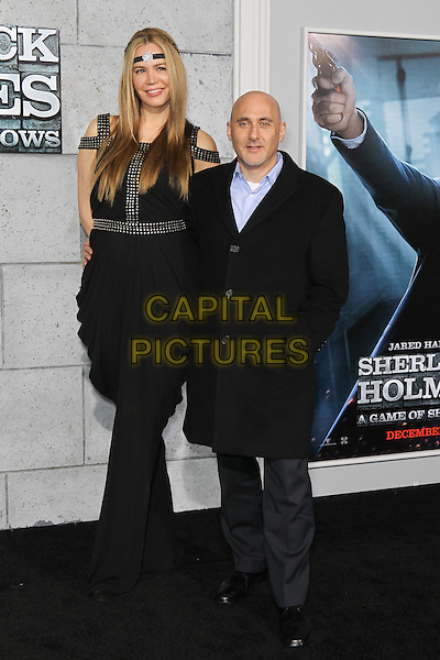 NICOLE ROBINOV, JEFF ROBINOV.The World Premiere of 'Sherlock Holmes: A Game of Shadows' held at The Village Theatre in Brentwood, California, USA..December 6th, 2011.full length black suit trousers headband tall short married husband wife.CAP/CEL .©CelPh/Capital Pictures.