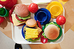 "September 14, 2011. Raleigh, NC. . Fake food in the ""restaurant"" in the class.. Project Enlightenment, a public pre-kindergarten program for at risk children, has been threatened with closure due to state wide budget cuts.."
