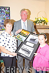 PRESENTATION: Maureen Gamble and her grand-daughter ))))))) made a special presentation to Ceann Comhairle John O'Donoghue at the opening of the Killorglin Family Resource Centre in Iveragh Park on Friday last.