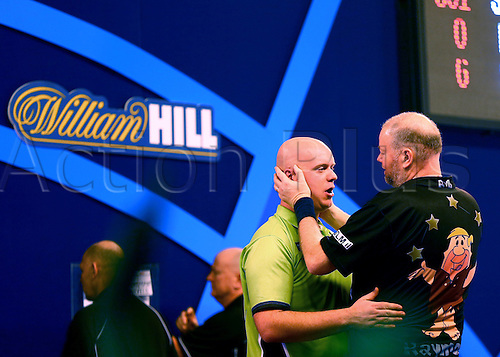 01.01.2017. Alexandra Palace, London, England. William Hill PDC World Darts Championship. Michael van Gerwen is congratulated by Raymond van Barneveld on his win, and securing his place in the Final