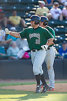 Tyler Horan (39) of the Augusta GreenJackets high fives teammates after hitting a home run against the Hickory Crawdads at L.P. Frans Stadium on May 11, 2014 in Hickory, North Carolina.  The GreenJackets defeated the Crawdads 9-4.  (Brian Westerholt/Four Seam Images)