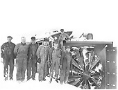 D&amp;RGW rotary snow plow OY at Cumbres with six workmen standing to left of plow and one workman on top of plow.<br /> D&amp;RGW  Cumbres, CO  ca 1933