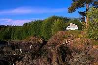 RV Recreational Vehicle Camper Van camping on Rugged Coastline near Port Hardy, Vancouver Island, BC, British Columbia, Canada