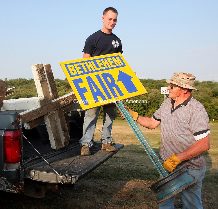 Bethlehem, CT-06 September 2007-090607MK01 (from left) Marty Rajcok, one of countless volunteers at the fair, takes a sign from Mark Suchcicki a director for the annual event.  The two loaded the truck with directional signs which they placed Thursday afternoon to guide visitors along various local routes to the Annual Bethlehem Fair which starts today from 5 PM to 11 PM, tomorrow from 8 AM to 11 PM and Sunday 8 AM to 5 PM. Michael Kabelka / Republican-American  (from left) Marty Rajcok, one of countless volunteers at the fair, takes a sign from Mark Suchcicki a director for the annual event)CQ