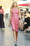Devon walks runway in a Douglas Hannant Resort 2012 outfit, on the USS Intrepid, June 7, 2011.
