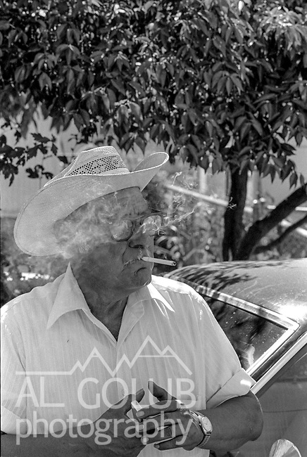 June 1981&mdash;Empire Camp-- <br /> Labor Camp Manager<br /> Bee reporter Juan Esparza Loera and I went to the Labor Camp on the edge of Empire, California.  The camp manager greeted us; he attempted to stick to us like glue but after a while he got tired and went back to his office.  Giving Juan a chance to find out really what was going on in the camp.  I discovered that two of the young men I was talking with were freshmen at Texas A&amp;M and were going to go back to their homes in Texas two weeks before school starts.  One said he had been coming to California to harvest crops since he was little boy and wanted to graduate college so he didn&rsquo;t have to bring his family back to harvest crops for a living.  Photo by Al Golub/Modesto Bee