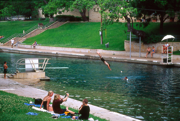 Barton Springs Pool is a man-made recreational swimming pool located on the grounds of Zilker Park in Austin, Texas. The pool exists in the channel of Barton Creek and is filled by water from Main Barton Spring, the fourth largest spring in Texas. The pool is a popular venue for year-round swimming, as its temperature maintains a narrow range from about 68.0 °F (20.0 °C) in the winter to about 71.6 °F (22.0 °C) in the summer