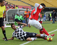 BOGOTA - COLOMBIA -22 -03-2014: Enrique Perez (Der.) jugador de Independiente Santa Fe disputa el balón con Javier Sanguinetti (Izq.) jugador de Boyaca Chico FC, durante partido por la fecha 12 de la Liga Postobon I-2014, jugado en el estadio Nemesio Camacho El Campin de la ciudad de Bogota. / Enrique Perez (R) jugador of Independiente Santa Fe vies for the ball with Javier Sanguinetti (L) player of Boyaca Chico FC during a match for the 12th date of the Liga Postobon I-2014 at the Nemesio Camacho El Campin Stadium in Bogota city, Photo: VizzorImage  / Felipe Caicedo / Staff.