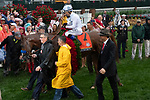 LOUISVILLE, KY - MAY 5:  Justify, trained by Bob Baffert, ridden by Mike Smith,being led into the wInners circle by WInstar Farm owner Kenny Trout after capturing the 144th running of the Kentucky Derby at Churchill Downs on May 5, 2018 in Louisville, Kentucky. (Photo by Eric Patterson/Eclipse Sportswire/Getty Images)