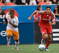 18 July 2009: Toronto FC forward Pablo Vitti #8 takes the ball up field as Houston Dynamo midfielder Corey Ashe #26 gives chase in a game between the Toronto FC and Houston Dynamo..The game ended in a 1-1 draw..