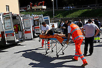 An injured woman is carried into an ambulance outside of the village of Amatrice, central Italy, hit by a magnitude 6 earthquake at 3,36 am, 24 August 2016.<br /> Una donna ferita viene caricata in ambulanza all'esterno dell'ospedale di Amatrice dopo il terremoto magnitudo 6 che alle 3,36 del mattino ha colpito la zona, 24 agosto 2016.<br /> UPDATE IMAGES PRESS/Riccardo De Luca