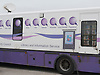 Woman using North Yorkshire County Council mobile library and information service.