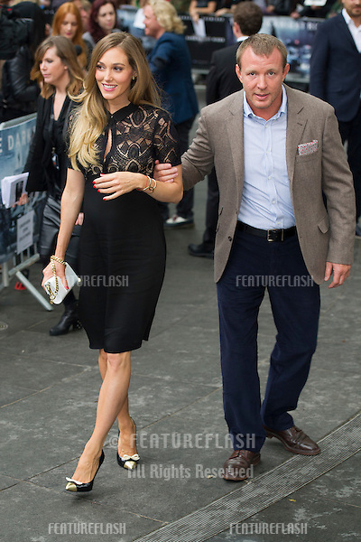 "Guy Ritchie and Jacqui Ainsley arriving for European premiere of ""The Dark Knight Rises"" at the Odeon Leicester Square, London. 18/07/2012 Picture by: Simon Burchell / Featureflash"